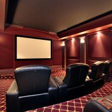 Theater in luxury home with large leather chairs
