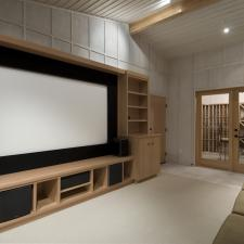 Home theater with wine tasting room big screen wood cabinets